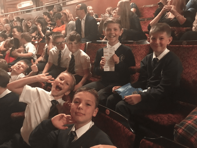 Students watch on from the theatre in the West End