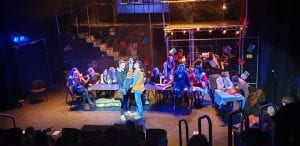 College students during the production of Rent.