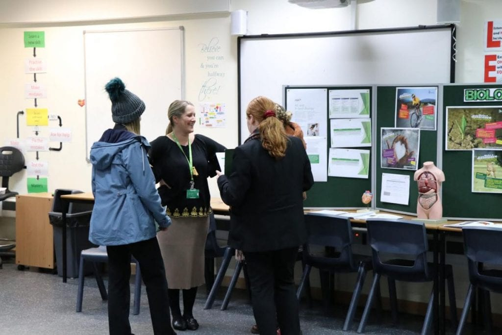Staff explain new curriculum to students.