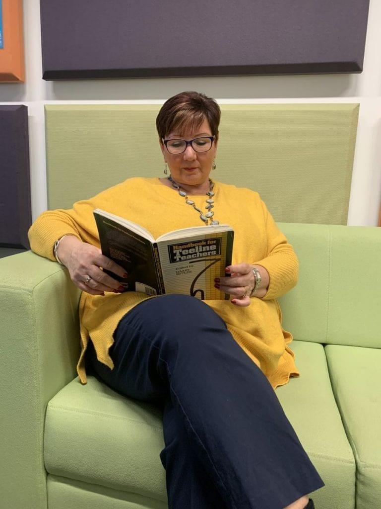 Jackie Deering looking at her teeline book